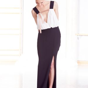 Long black white evening gown with rose gold detail front slit