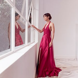 Halter neck silk ball gown in raspberry and pink with bow detail and slit