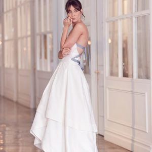 White wedding gown with full skirt, sweetheart bodice and lavender straps and bow